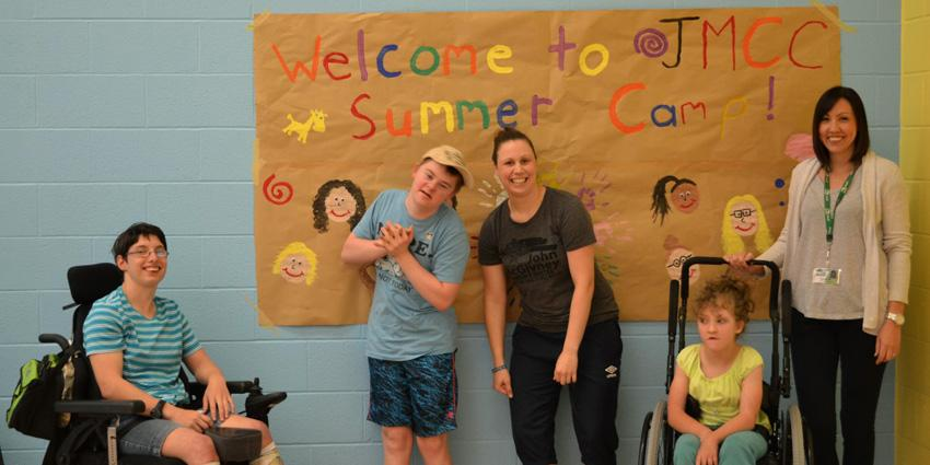 JMCC Summer Campers in front of sign