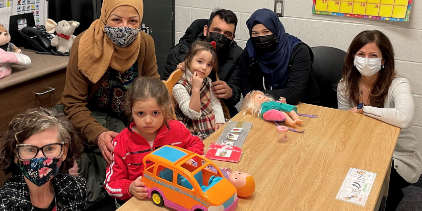 JMCC CEO Jessica Sartori (left) with interpreter Mozayan Diab (second left) members of the AlHariri family and Speech Language Pathologist Agapi Varacalli (right).